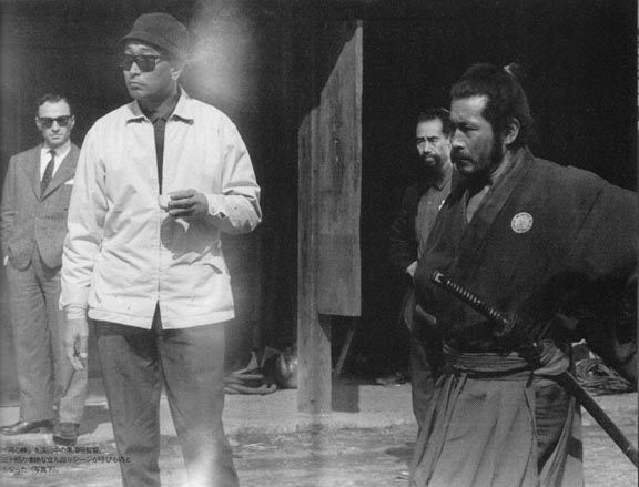 Master Yoshio Sugino (in the background) choreographing a fight scene on the set of Yojimbo with legendary director Akira Kurosawa (white jacket) and famed actor Toshiro Mifune . As a matter of fact, Mr. Mifune was a student of Katori Shinto Ryu under Master Sugino.